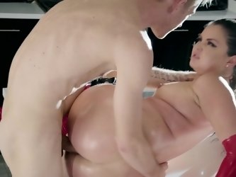 Latex courtesan is banged in ass in the kitchen