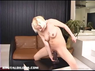 Dashing solo model with natural tits masturbating with a huge dildo