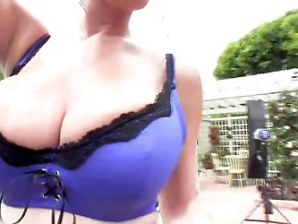 Lana Kendrick pops out of her blue bra
