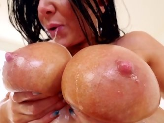 Sexy oiled up titjob from milf hottie Romi Rain