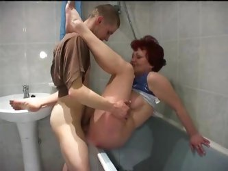 Redheaded granny goes young in bathroom