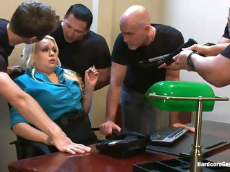 With guns in front of her face the blonde milf gets scared and obeys these guys. They want to use her body so they grab the slut, lay her on the desk