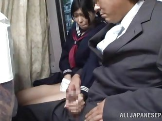 The cute asian schoolgirl got the wrong chair, or perhaps the right one because she is sitting near a pervert. The guy doesn't cares that the bus