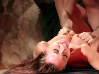 A bimbo with natural boobs is getting pounded in her cunt deeply